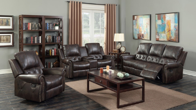 Three-piece brown leather reclining living room set with coffee table display