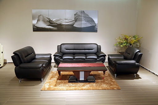 black leather couch, loveseat and single chair with coffee table display